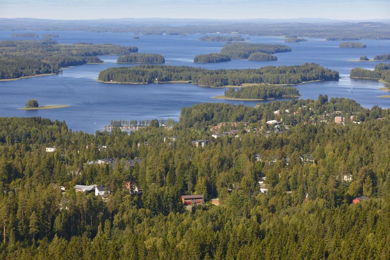 Kuopio village in Finland. Island, forest lake. Finnish landscape. Horizontal